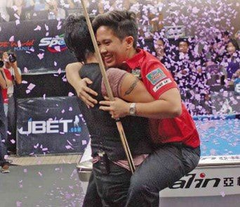 Great pic of Amit losing control for a moment jumping into Fisher's arms - Pic by The Philippines Inquirer Sports