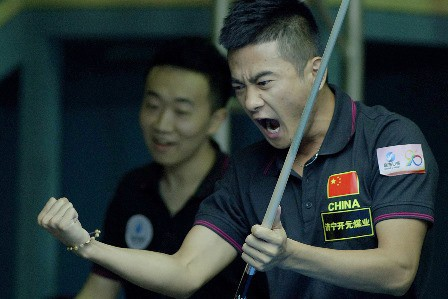 Dang Jinhu celebrated his 8 Ball doubles win with Wang Can