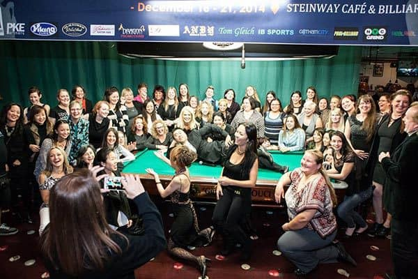 In a night full of great food, laughs, and fun...the 64 ladies got the event promoter Charlie Williams to strike a pose. Billiard style of course - Eli Ceballos
